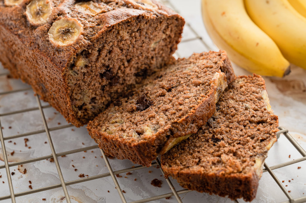 Food photography banana bread loaf with chocolate chips on a cooler rack