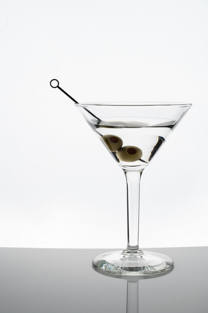 martini cocktail drink photography with olives, liquor, on white background