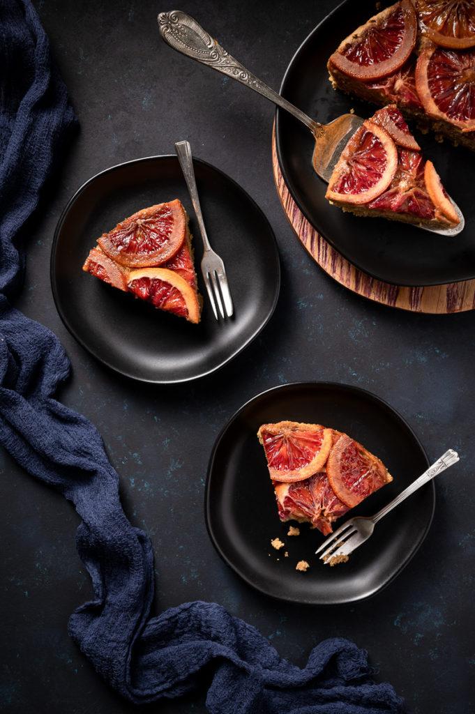 Bakery photography, blood orange upside down cake, orange, blue napkin, forks