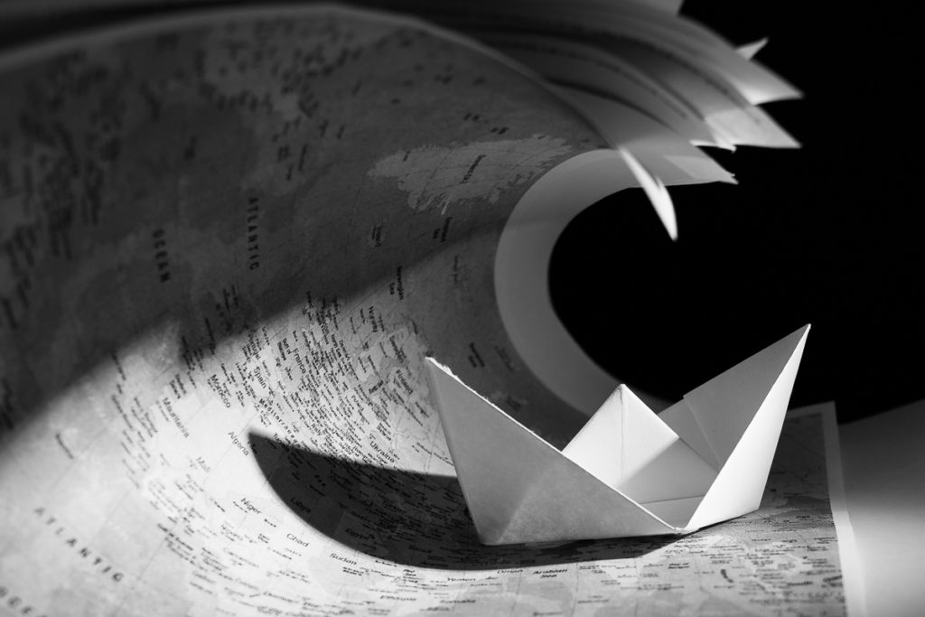 Black and white photography of a paper boat