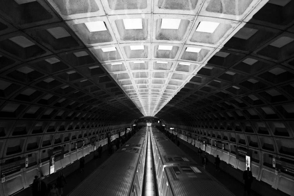 Photography of subway station in black and white