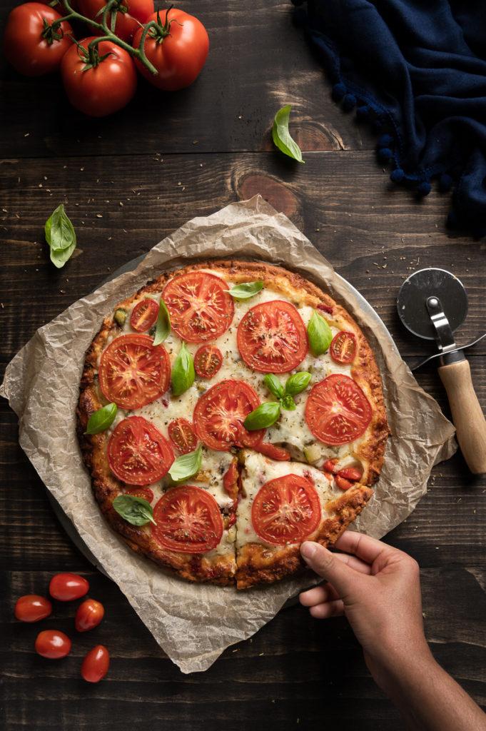 Margarita pizza with mozzarella cheese, cherry tomatoes, Campari tomatoes, fresh basil, oregano and pepper