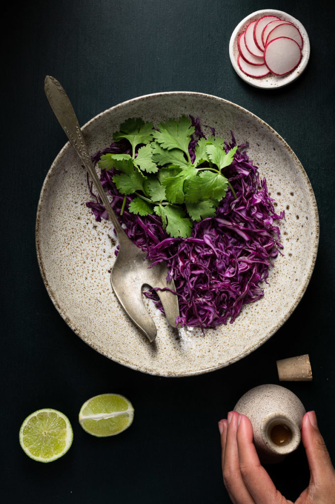 Red cabbage salad with cilantro, radish, lime and dressing